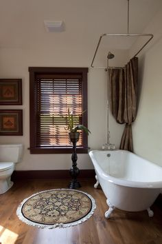 Freestanding Claw Foot Tub And Shower Combination With Hanging Shower  Curtain.