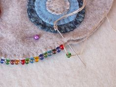 ThreeSheepStudio: How To Do A Beaded Blanket Stitch. Catch bead after comple. - ThreeSheepStudio: How To Do A Beaded Blanket Stitch…. Catch bead after completing each blanket s - Felt Embroidery, Felt Applique, Cross Stitch Embroidery, Embroidery Patterns, Print Patterns, Penny Rugs, Blanket Stitch, Crochet Blankets, Wool Felt