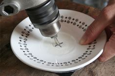 Starting off at an angle when drilling a hole in a ceramic plate