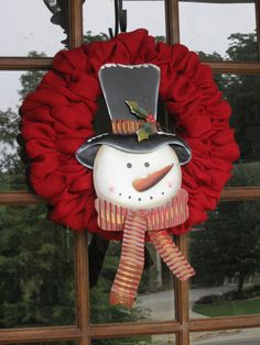 Red burlap wreath with metal Snowman sign on Etsy, $55.00