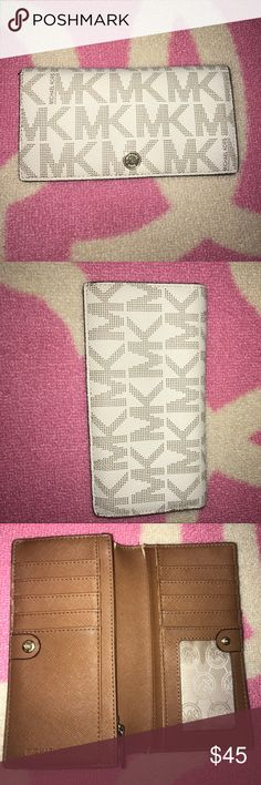 Michael Kors Wallet❤️ Authentic preloved michael kors wallet. Has some wear to it as seen in pics. Measurements are 7x4. Feel free to ask any questions or make an offer! Michael Kors Bags Wallets