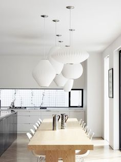 bright dining with nelson pendant lamps