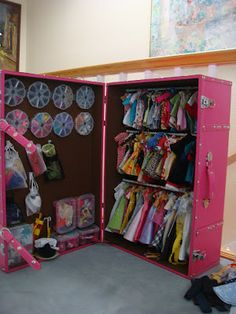 What an awesome storage idea for the girls' Barbie clothes!  Bead containers = shoe storage - clever!