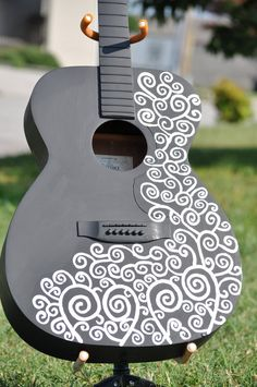 Sand, paint, stencil. I may have to do this to my daisy rock acoustic.