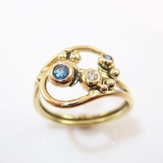 Gold wave wrapping ring with blue gems and diamond OOAK by Castens on Etsy https://www.etsy.com/listing/110536435/gold-wave-wrapping-ring-with-blue-gems