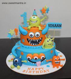 Cute Monsters theme customized designer 2 layer colorful fondant cake - http://cakesdecor.com/cakes/278148-cute-monsters-theme-customized-designer-2-layer-colorful-fondant-cake