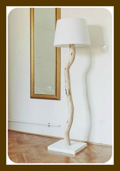 Cool DIY Tree Branch Lamp Tutorial How to make your a DIY tree branch lamp. Step by step tutorial for making your own tree branch floor lamp- a fairly easy DIY project that results in beautiful, one-of-a-kind home decor. Diy Floor Lamp, Wood Floor Lamp, Wood Lamps, Diy Table Lamps, Tree Floor Lamp, Homemade Lamps, Homemade Tables, Cool Diy, Easy Diy