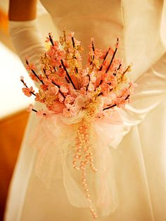 The flower bouquet of a peach but would be perfect for a cherry blossom wedding!!!!!!!