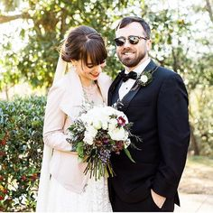 Our favorite part about our job is seeing our brides unique wedding days come together We love how our bride Anne showcased her awesome style with this hip blush pink jacket and her groom's awesome shades!  @mary_margaret_smith  #villagebridalhomewood #truvellebridal #taylorgown #realbride #birminghambride #alabamaweddings #southernwedding