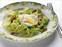 Frisee salad with poached egg  https://zoxkitchen.com/food/salads-for-lunch-and-dinner-too-2/