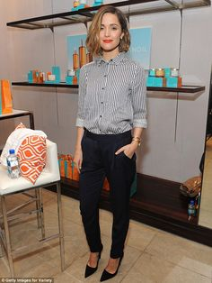 Menswear inspired: Earlier in the day, Rose donned a black and white pinstriped blouse pai...