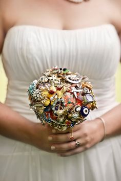Vintage brooch bouquet....a client of mine had each person at all her showers bring a broach and they made her boquet out of them very different!