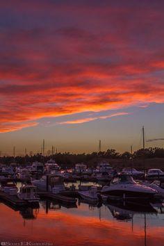 Orange and Gold Sunset Over Marina  #Sunset #MyrtleBeach #SouthCarolina #Gold #Golden #Orange #Sun #Cloud #Clouds #Reflection #Reflections #SunReflections #Boat #Boats #Marina #Sky #BlueSky #CloudySky #Cloudy #February #FebruarySunset #Photo #PhotoOfTheDay #POTD #Photography #Photographer #Canon #CanonPhotographer