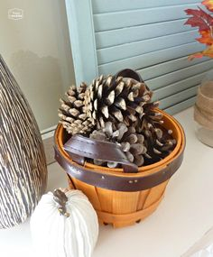 pinecones on the late fall mantel at thehappyhousie