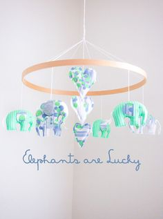 The elephant is an ancient symbol of strength, protection and good luck. What a beautiful sentiment to bring into your baby nursery with this beautiful handmade mobile. It features six sweet little elephants and three central hearts suspended from a smooth wooden ring. Elephants are Lucky was handmade by me in my light filled home studio in the quiet Australian seaside village of Barwon Heads. It is ready to ship and will arrive at your door ready to hang (ceiling hook is included). ...