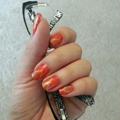 simple orange/red polish with gold glitter