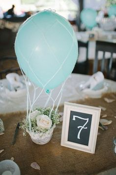 Hot air balloon centerpiece... so fun and one you could even make yourself.
