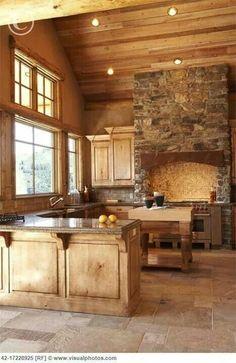 Beautiful open kitchen design, stone and wood.