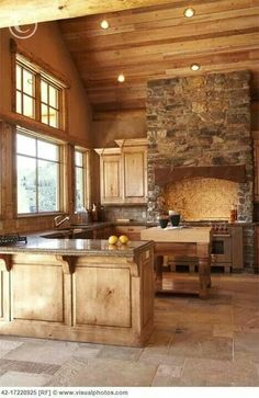 Beautiful open kitchen design, stone and wood.