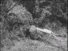German Sniper using Mauser K98k With Scope during World War II The Germans improved their Sniping techniques through better camouflage, stealth technology, automatic rifles, silencers , scope Hoods .