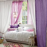 daybed under window with drapes