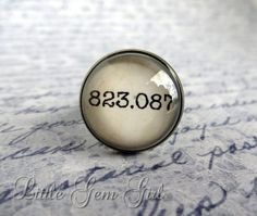 """Dewey decimal ring: """"This fun and unique ring is perfect for book lovers, librarians, school teachers, etc! 823.087 is the Dewey Decimal section for sci fi, fantasy, horror and detective stories."""""""