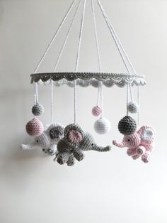 This lovely crochet baby mobile with cute baby elephants, little good luck bringers for a newborn, makes a beautiful, one of a kind baby shower gift. The baby mobile is made of 100% cotton yarn in white, pink and two shades of gray. It is ideal to hang over a baby crib, baby changing table or simply anywhere in the nursery just to brighten up the babys room. The item is handmade with love and care. Color: white, light pink, light gray, dark gray Material: 100% cotton yarn, metal ring…