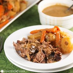 The Perfect Pot Roast Recipe with instructions to make it in the oven or slow cooker! Seasoned just right and served with homemade gravy and tender carrots, onions and potatoes, this will be your new go-to recipe!