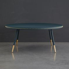 Bethan Gray coffee table with brass detailing on the rim and the legs.