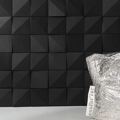 """Offset"" medium size (20x20 cm) architectural wall panels arranged randomly. Made by ORIGINEPIETRA. #design #interior #contemporary #modern #new #concrete #pattern #surface #texture #black #ceramic"