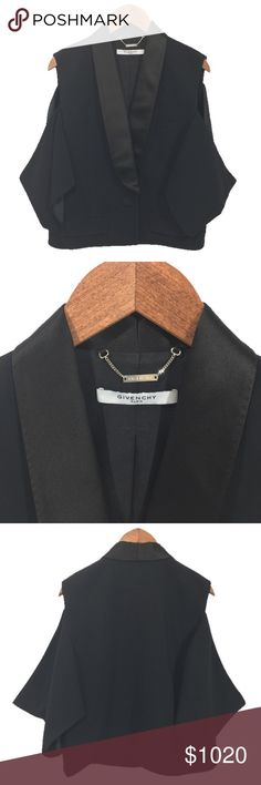 GIVENCHY COLD SHOULDER TUXEDO BLAZER GIVENCHY COLD SHOULDER TUXEDO BLAZER. SILK LAPELS. SINGLE BUTTON FRONT CLOSURE. FOLD OVER FLAP POCKETS X2, FRONT. SINGLE POCKET AT BUST. CONDITION: GENTLY USED/ NO SIGNS OF WEAR. FABRIC: VISCOSE/ ELASTHANE/ SILK. SHOULDER- HEM: 22'' SIZE 40 Givenchy Jackets & Coats Blazers