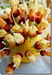 A fun fresh snack for a Springy Snack Table... All it takes is a melon for a base, some skewers and slices of your favorite brightly colored fruits for a snack bouquet that will have everyone raving.