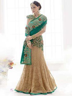 Grandiose beige and teal green color jacquard net and #Chiffon Saree with resham, stone and zari work. Item Code: SAV3820 http://www.bharatplaza.com/new-arrivals/sarees.html