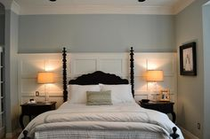 I love the walls, colors, and crown molding in this bedroom.
