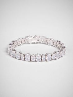 Traditional tennis bracelet styling gets an elegant update thanks to gorgeous oval crystals in varying sizes.