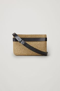 A versatile design that can be used a shoulder bag or clutch, this bag is made from textured raffia with a leather detail along the front. Fitted with a removeable belt-style leather strap, it has a lined compartment with metal zip fastening. Black Sandals, Leather Sandals, Black Shoes, Handbags On Sale, Luxury Handbags, Cow Leather, Smooth Leather, Evening Bags, Cos