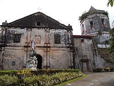 Maribojoc Church, also known as Santa Cruz Parish Church or Holy Cross Parish Church, was a Roman Catholic Church in the municipality of Maribojoc, Bohol, Philippines, under the Roman Catholic Diocese of Tagbilaran. The parish was first established by the Jesuits in 1767 or 1768 with Father Juan Soriano, SJ as its first parish priest. The Augustinian Recollects later administered the community until 1898.