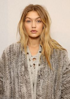 Au naturele: Gigi displayed her flawless, natural beauty, including her pretty blonde tres...