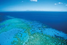 Aerial shot of the Great Barrier Reef by Tourism Queensland