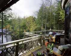The rustic twig design of the railing is a nice touch around this deck with a river view in North Carolina.
