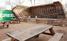 This is a wicked outdoor music stage made of wooden palettes at a new place in Dallas, TX
