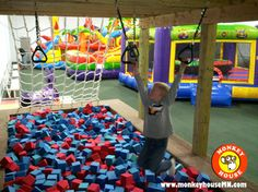 Monkey House in White Bear Lake: Giant inflatable bounce houses, obstacle course, 18' Slide, climbers, foam pit and more!
