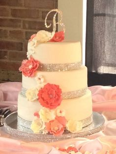 Coral silver wedding cake with purple instead of coral