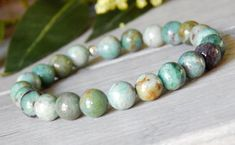 About the Bracelet Chalcedony or Prase Gemstones are a stone of good will. The calming green stones will lift your spirits on this simple gemstone bracelet. Bracelet Details: This simple gemstone brac