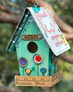 Upcycled birdhouse - Love the washers and bottle caps used as decorations