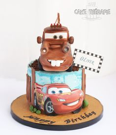 Tow Mater and Mc Queen cake. Tow mater made with RKT and fondant. A cake finished in Buttercream and put together with fondant accents.