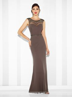 Twill slim A-line gown with hand-beaded illusion slight cap sleeves and jewel neckline, sweetheart bodice, matching beaded illusion back, beaded natural waistline. Matching shawl included. Sizes: 4 – 20 Colors: Smokey Mink, Cobalt Blue, Black