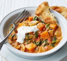 This quick and easy vegetarian curry is perfect for a healthy weeknight dinner - with butternut squash, coconut milk, lentils and spinach
