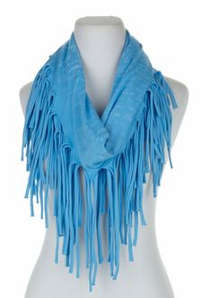 This @lyricculture fringe scarf will be a fun addition to your wardrobe! Layer it over your button down tops, your elegant tanks and all your casual, statement tees! This scarf is available in Blithe (light pink) and Persimmon (light blue)!