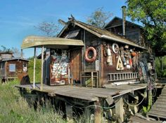 Now that's a fishing shack! Awesome shed idea for a cottage!
